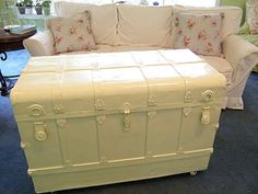 Trunk painted white, straps in pearlized white, interior recovered in vintage shabby chic fabric.