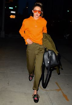 To start strong for spring, like Gigi Hadid here, take a bold orange hoodie and match with high-waist, khaki utility trousers. That's right, tangerine with army green. Sure, it sounds sketchy-as, but queen G has the style tips to make this mix happen. Slide on a pair of Gucci-esque embroidered mules (you'll be wearing these all summer through) and finish with matchy tinted orange sunnies. Yep, your off-duty life just stepped up a notch