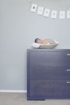 Adorable newborn photography in the nursery - capture how tiny they are in their own room!