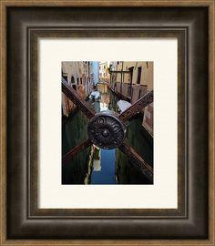venice Reflections By Marina Usmanskaya Framed Print featuring the photograph Venice Reflections by Marina Usmanskaya  An ancient grille on one of the numerous bridges of Venice  #MarinaUsmanskayaFineArtPhotograph #artforhome #HomeDecor #HomeDesign #Venice #Reflections #fineartprints