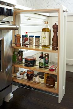 Sometimes you just need a spot to store all of the essentials — salt, pepper, olive oil, the works. This pull-out space next to the oven and stove will fill that hole in your life. See more at Anne Hepfer »  - GoodHousekeeping.com