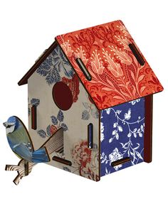 Ornamental floral bird box set    Make your own ornamental bird box with this novelty set, designed from Italian textiles and wallpapers it features mixed florals in red and blue and an elegant blue tit bird detail. This decoration looks great on its own or when combined with other bird houses to create an interesting wall feature.
