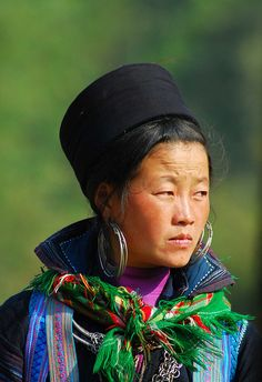 Asia | Portrait of a Black Hmong woman with traditional earring and hat, Vietnam | © Andre Roesli