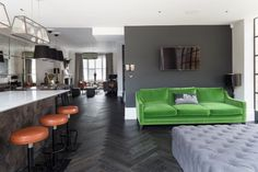 The citrus green velvet couch against the gunmetal gray wall. Surprisingly gorgeous.