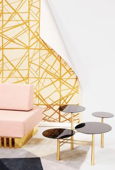 Any of these surprising elements — from hand-painted papers and graphic rugs to abstract tables and pink sofas — can brighten up a serious space.