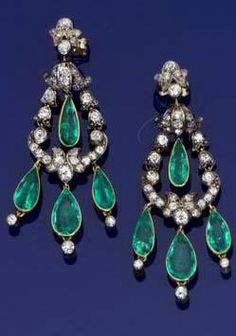 An early 20th century pair of emerald and diamond girandole earrings Each old brilliant-cut diamond bell-shaped motif with a pear-shaped emerald swing centre, terminating in three pear-shaped emerald and old brilliant-cut diamond drops, length 5.2cm., cased by Carrington & Co Ltd, 130 Regent St, W1.
