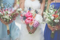 Peonies, thistles, and king proteas mixed with wild flowers.  Gorgeous!