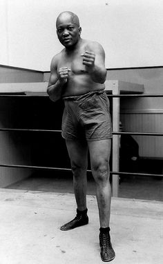 March 31, 1878 - Boxer Jack Johnson was born.  Boxer Jack Johnson, the first black world heavyweight champion, is shown posing in New York City in 1932 at the age of 54.  (AP Photo)