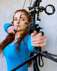 Virginia Hankins with a compound bow - A real talent behind the bow and other warrior activities.