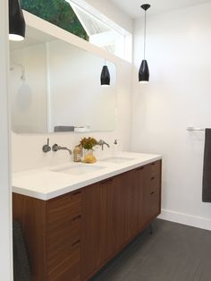 San Francisco Interior Design company Regan Baker Design -  Noe Valley Danish Modern Bathroom, Midcentury Modern, Freestanding Wood Vanity, Recessed Routed Pulls, Wall Mounted Faucet, Curved Rectangle Frameless Vanity Mirror, Black Vanity Pendant Lighting