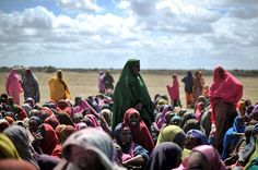 Afgoye, Somalia — Refugee women wait at a food distribution center. PHOTOGRAPH BY: TOBIN JONES / AFP/GETTY IMAGES