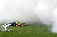 A Fenerbahce soccer fan lies on the pitch unconscious during clashes with riot police after their team's Turkish Super League, Super Final match against Galatasaray at Sukru Saracoglu stadium in Istanbul.