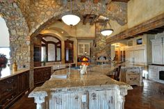 I like the stonework and the light airy feeling of this kitchen
