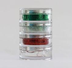 Mini-torre de glitter de colores patrios con gel aplicador.