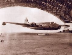 Canberra low pass through a hangar not sure of date. This guy had to be crazy!