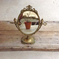 Buy on Etsy Ornamental Antique Rococo Brass Vanity Mirror by FrenchMarketFinds