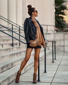 Black mini skirt, black moto jacket with camel top, cross body and Sorel hiking boots. #fall2020style Edgy Outfits, Grunge Outfits, Grunge Fashion, Camel Tops, Leather Jacket Outfits, 2020 Fashion Trends, Rocker Chic, Girls Party Dress, Girls Night Out