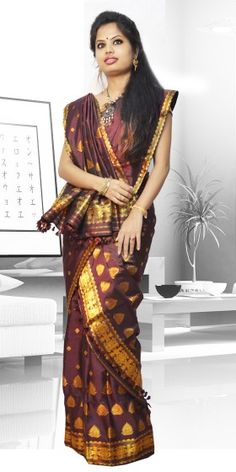 Beautiful Brown colour Assam silk pat Mekhla Chadar with artistic Guna work giving a stylish look to the two piece. This gorgeous collection is perfect for any festive occasion.The Mekhla Chadar is a two pc. Saree which comes with matching blouse piece, the blouse shown in the image is just for display purpose.Slight colour variation may be there in display & acutal.