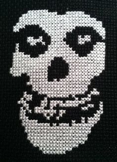 A Misfits cross stitch. Pattern bought here: [link] Done with three threads on black Aida cloth. Cross Stitching, Cross Stitch Embroidery, Cross Stitch Patterns, Halloween Skull, Halloween Crafts, Cross Stitch Skull, Horror Room, Hama Beads Patterns, Misfits