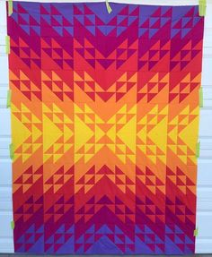 Beautiful HST quilt made with solids