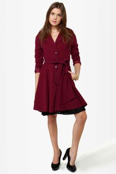 """What you already love about the Darling Helena Burgundy Frock Coat is just the tip of the ice""""burg""""! Wonderful wine red twill composes a princess-seamed bodice with shoulder epaulets and four chunky buttons down the front. A shortened collar widens into standard-sized lapels, and a flared bottom-half fits with a belted waistline. Side seam pockets. Fully lined in wine red satin. Model is wearing a size X-Small. XS measures 34.5"""" long. 27"""" sleeve (from neckline). 28"""" w..."""