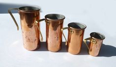 VINTAGE COPPER and Brass Handles Measuring Cups Set that  Stack Away with Beautiful Patina. $35.00, via Etsy.