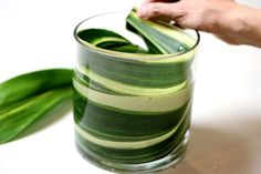 Line the vase with leaves