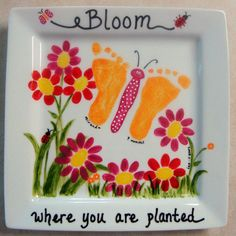 Mother's Day Idea for my daughter-in-law: a beautiful plate with the baby girl's footprints making the butterfly wings, and her older brother's fingerprints making the center of the flowers. For Ben
