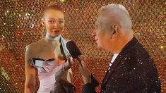 In an exclusive interview at the British Fashion Awards, Gigi Hadid talks to Jean Paul Gaultier, about the dress she is wearing, while JPG says she is the 'crystal by herself.'