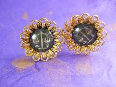 These are a beautifully Black eye Susan design cufflinks with a reversed painted Scales of Justice in the center. A very elegant pair of cufflinks for the women of law.This is the Time to be thinking of the upcoming holidays and what better way then that something for the men that have everything! This would be a great idea because it is Vintage and not something you can buy Everyday. OR perhaps Just A perfect addition to a collection.Boxed for gift giving; gift wrapped on request.? Maker…