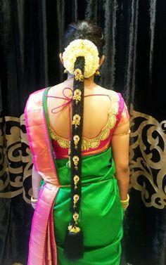 South Indian bride. Gold Indian bridal jewelry.Temple jewelry. Jhumkis. Green and pink silk kanchipuram sari.Braid with fresh flowers. Tamil bride. Telugu bride. Kannada bride. Hindu bride. Malayalee bride.Kerala bride.South Indian wedding.