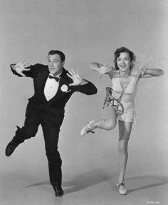 Full publicity shot of Gene Kelly as Don Lockwood, wearing tuxedo, dancing with Debbie Reynolds as Kathy Selden.