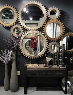 These is very bold arrangement of the wall in the hallway or living room. The gears are actually a mirror frame. A wall arranged in this way definitely returns to history.