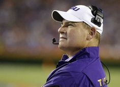 In this Oct. 11, 2014, file photo, LSU head coach Les Miles looks at the scoreboard during the first half of an NCAA college football game against Florida ...