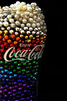 Cool Coca Cola Coke Glass with filled with colored rainbow beads