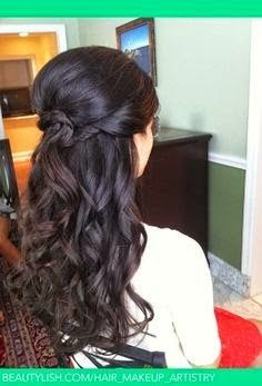 Looks like a half up do with a messy/curled/braided bun? with tons of curls under!