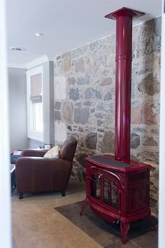 Charming red wood burning stove in this stone walled farmhouse eclecticallyvintage.com