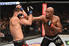 LAS VEGAS, NV - JANUARY 31:  (R-L) Anderson Silva punches Nick Diaz in their middleweight bout during the UFC 183 event at the MGM Grand Garden Arena on January 31, 2015 in Las Vegas, Nevada.  (Photo by Josh Hedges/Zuffa LLC/Zuffa LLC via Getty Images) *** Local Caption *** Anderson Silva; Nick Diaz