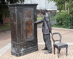 CS Lewis peeps into a wardrobe: a statue in east Belfast- firmly placed on the long list of places to visit