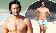 Jay Lyon showcases his VERY muscular physique on Bondi Beach