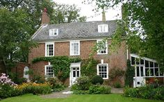 """'The residents of Moulton agree with Pevsner that theirs is """"the most satisfying village in the neighbourhood"""", and Harrington House is certainly one of the most charming residences.' PS. How I wish American houses were allowed to have front walls like this one."""