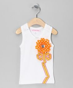 The ribbon stem and silk flower make this tank anything but basic. The bright colors and rhinestone detailing on the collar ensure darlings will be dressed to impress.   Cotton / satin / silkMachine wash; hang dryImported