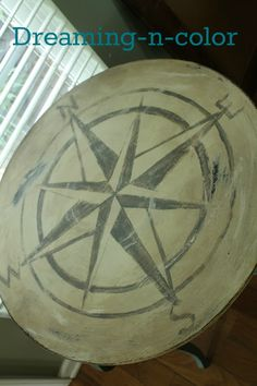"""dreamingincolor: Compass Table Love this hand-painted table! We painted this EXACT compass on nursery ceiling """"travel/safari"""" theme using a projector!"""
