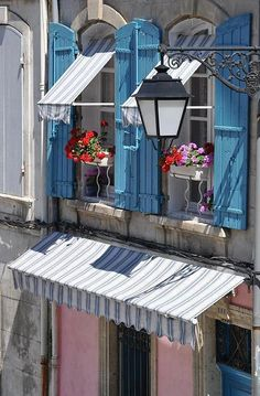 patio/kitchen window, blue shutters, fabric awnings.  LOVE the idea of putting a hanging light at the end of that fancy scrolled arm!! Provence
