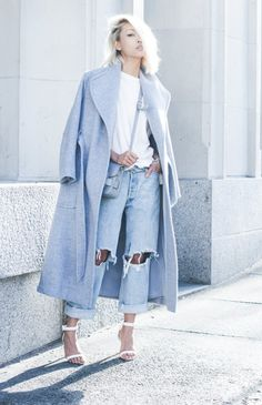 Washed out blue hues: oversized coat + distressed boyfriend jeans + strappy white heels  on Vanessa Hong of The Haute Pursuit