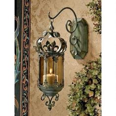 Embellish your castle hallways with this richly ornate, hand-tooled metal scrollwork pendant wall mounted Candle Holder embellished with fleurs-de-lis and fitted with an elegant smoked glass insert. Suitable for your home or garden. | eBay!