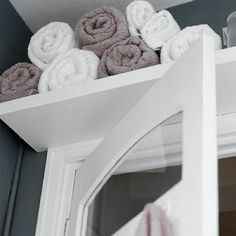 Over Door Storage - thinking for our hall bath and not for towels but baskets of soaps, paper, etc
