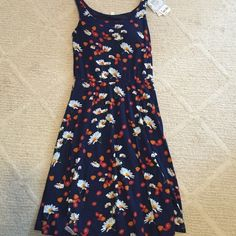 Uniqlo Print Dress I have never worn this dress. It has a built in bra. The print has flowers with a striking dark blue background. Dresses Midi