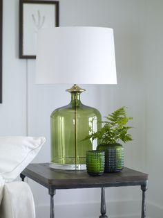 We've given a classic shape a contemporary twist. Each mouth-blown Nolan in black, clear glass, or translucent green is fitted with an antiqued brass collar and wiring rod. A thick acrylic base adds r