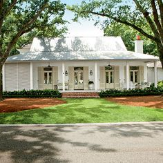 Creole-French-style cottage beckons visitors in with an easygoing porch and a simple, modern design - Breezy River House Exterior - Southern Living Style At Home, Future House, My House, House Porch, Farm House, Tin Roof House, House Front, House With Metal Roof, White Siding House
